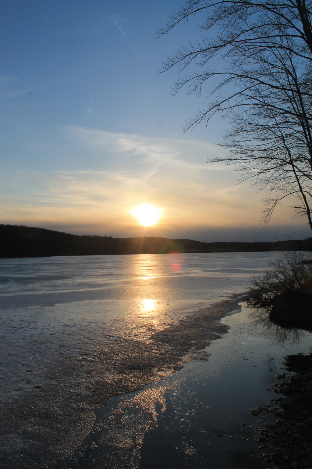 Photo: Setting Sun Over Frozen Lake
